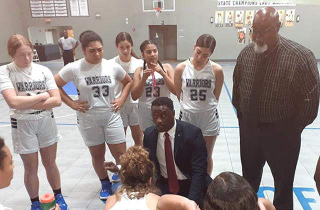 NEWS-GAZETTE PHOTO/J. DANIEL PEARSON Head Coach Dewrie Buggs talks to his City of Life team during a timeout of last Tuesday's 70-30 Regional Semifinal win over Trinity Christian.