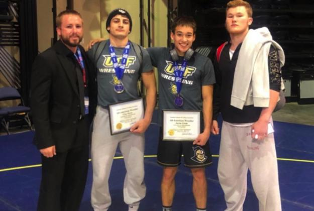 From left are: Head Coach CJ Cook, Clay Perry and UCF teammates Justin Trinh (national runner-up in the 141-pound weight class) and Jarrod Smiley (national runner-up in the 184-pound weight class).
