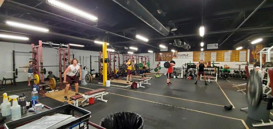 Using social distancing guidelines, the St. Cloud football team hit the weight room in small groups during workout sessions.  Photo courtesy of Bryan Smart/St. Cloud Football