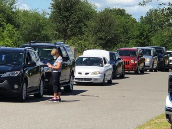 At the last distribution on May 7, 800 cars, representing 1,241 families and 3,131 household members, received 47,000 pounds of food by day's end.