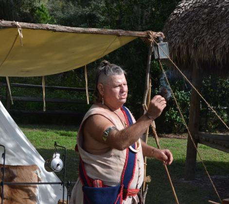 Swamp Cabbage (Stephen Teeter) demonstrates fire-making at the Seminole camp at Pioneer Village. Living History Day at Pioneer Village on Nov. 14 will feature Seminole demonstrations, storytelling and a mini archaeology dig for children.