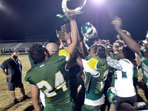 Liberty football players celebrate by mobbing head coach Brandon Pennington and the Battle of the Boulevards trophy following their 22-7 win over Poinciana.  It was the Chargers 14th consecutive win in the series in as many tries.  News-Gazette Photo/ J. Daniel Pearson