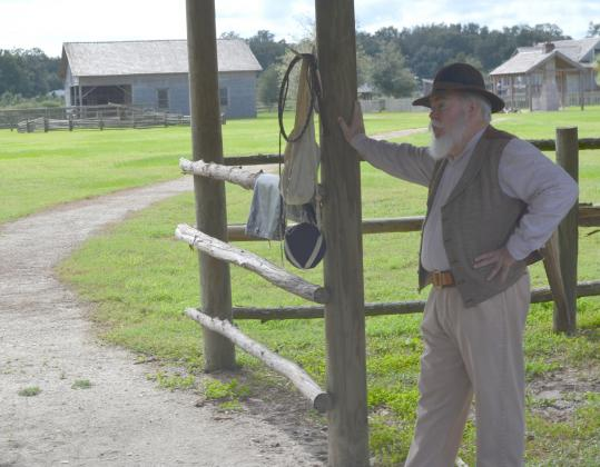 Retired history teacher John Holmes shares the history of the Florida cow hunters at Pioneer Village.