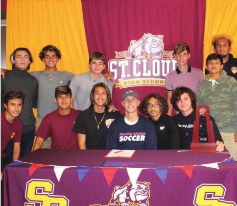St. Cloud Senior Goaltender Noah Craig (front row, center) is surrounded by his teammates as he signs his letter of intent to play soccer at Francis Marion SUBMITTED PHOTO