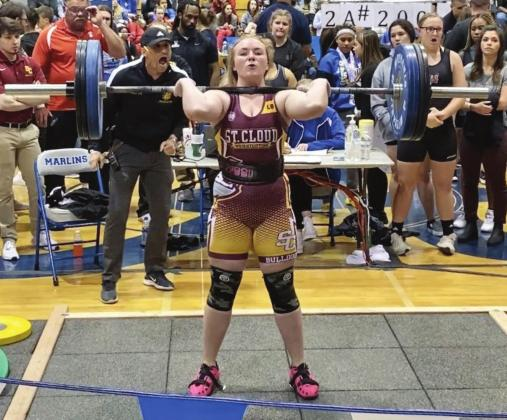 St. Cloud's Hannah Wagner successfully lifts 180-pounds in the Clean and Jerk on her way to the 183-pound championship. PHOTO COURTESY OF CORY AUN/ST. CLOUD WEIGHTLIFTING