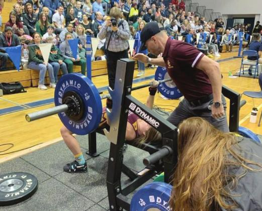 PHOTO/ST. CLOUD WEIGHTLIFTING St. Cloud senior Kaylin White successfully lifts 150 pounds in the bench press to help her capture the FHSAA State Championship in the 110-pound weight class.