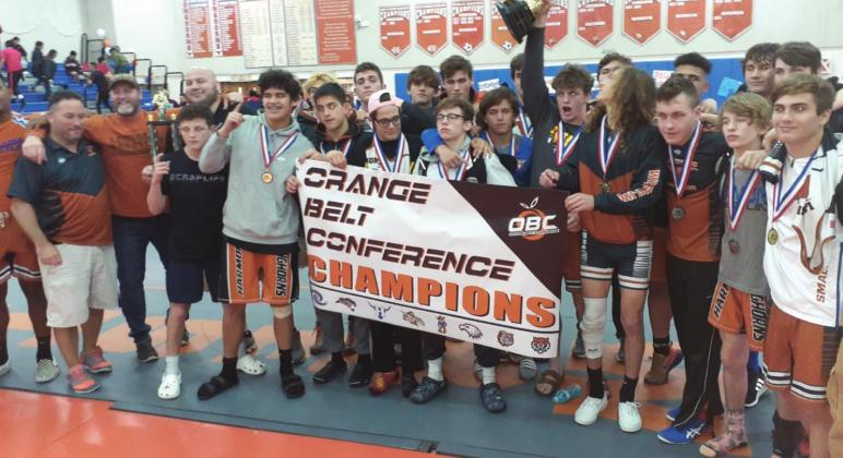 Harmony wrestlers and coaches celebrate the school's first OBC Wrestling Championship in school history, upending long-time champion Osceola in the process. NEWS-GAZETTE PHOTO/J. DANIEL PEARSON
