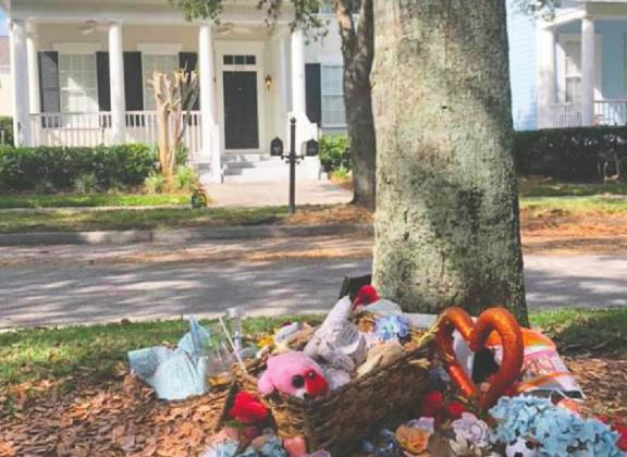 Community members placed stuffed animals and other memorial items in front of the Celebration home where Anthony Todt is accused of killing his family. PHOTO/FACEBOOK